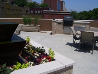 Our garden terrace offers a full grill, relaxing views of Mill Creek Park, and plenty of room for your guests.